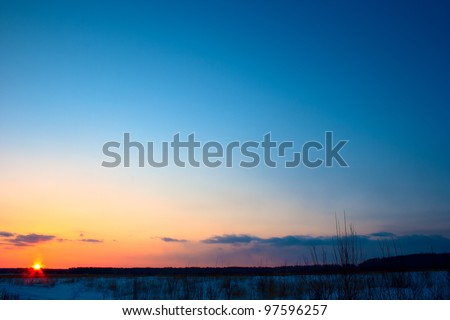 Winter sunset in the field - stock photo
