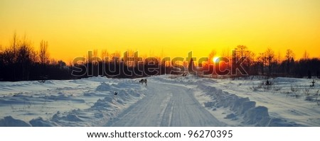 Winter sunset on the snow covered Road. - stock photo