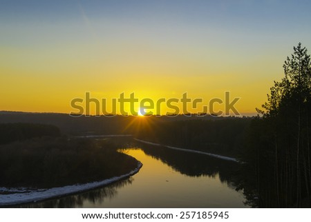Winter sunset over the river - stock photo