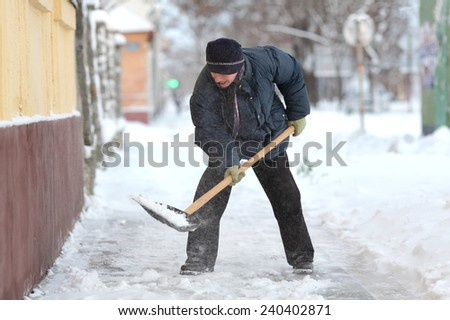 Winter time, snow removing - stock photo