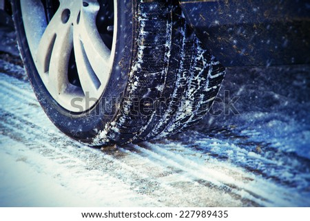 Winter tire on a cold winter day - stock photo