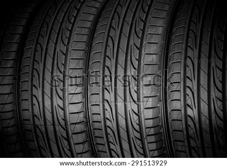 Winter tires close-up on black background - stock photo