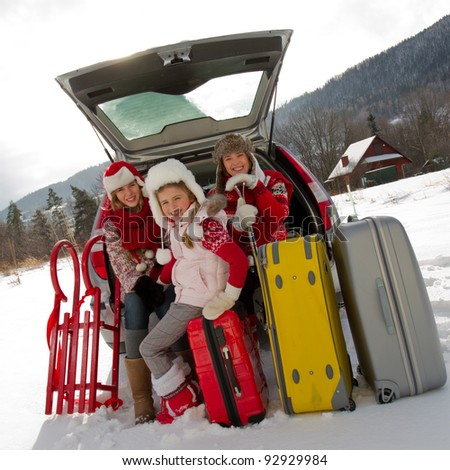 Winter, travel - family with baggage ready for the travel for winter vacation - stock photo