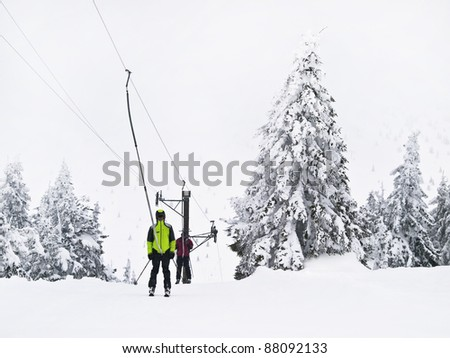 Winter tree boron / mountain Kopaonik Serbia / Old ski lift and two ski man - stock photo
