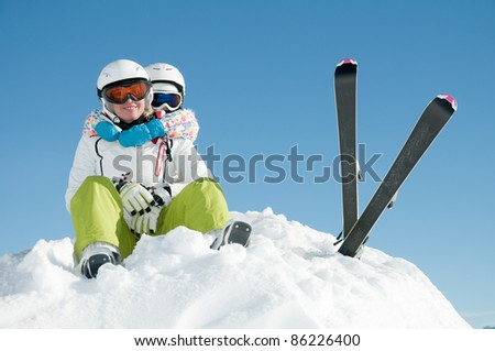 Winter vacation - portrait of skiers in ski resort - stock photo