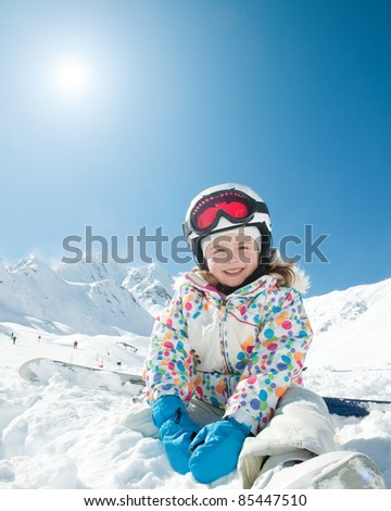 Winter vacation, ski - happy skier playing in snow (copy space) - stock photo