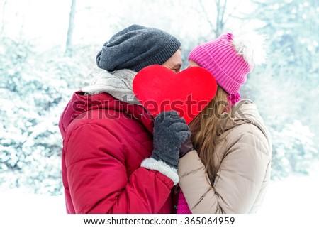 winter valentine couple in ice landscape - stock photo