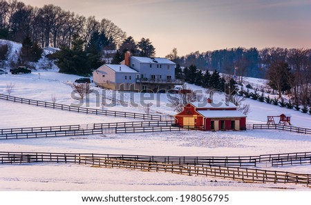 Winter view of a house and barn on farm in rural Carroll County, Maryland. - stock photo