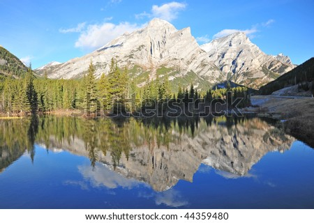 Winter view of a reflection pond and mountains in the morning, kananaskis country, alberta, canada