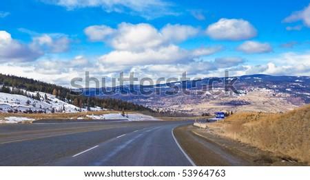 Winter view of mountain road to Okanagan valley, british columbia, canada - stock photo