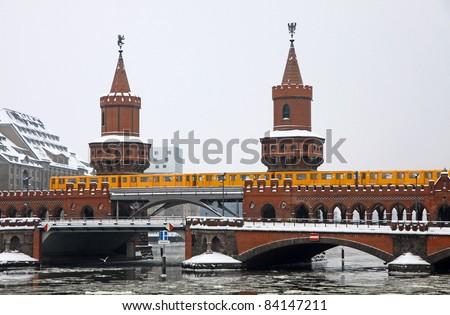 Winter view of Oberbaumbrucke bridge across the Spree river in Berlin, Germany. Is the longest bridge of Berlin - stock photo