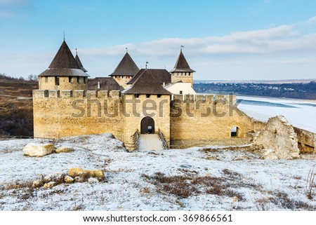 Winter view on ukrainian Khotyn Fortress on Dnister river, UKRAINE - stock photo