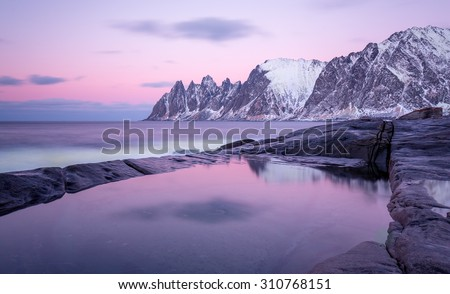 Winter view to Steinfjord on Senja island (Oksan on background). Troms county (long exposure) - Norway - stock photo