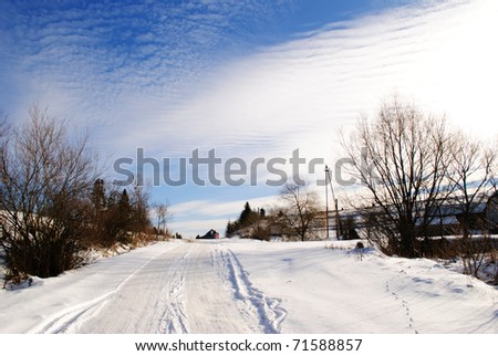 Winter villiage road and beautiful blue sky