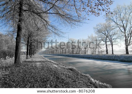 Winter water landscape with blue sky
