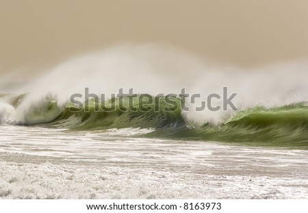 Winter wave in California crashes on the Beach. - stock photo