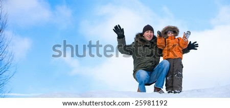 Winter weekend. Panorama of father and son on beautiful winter day outdoors. - stock photo