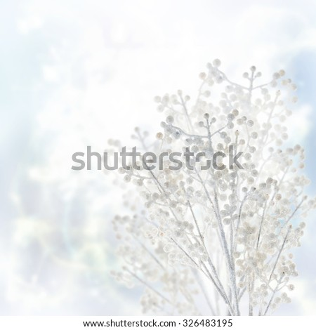 winter white tree branch on blue bokeh background with sparkles - stock photo
