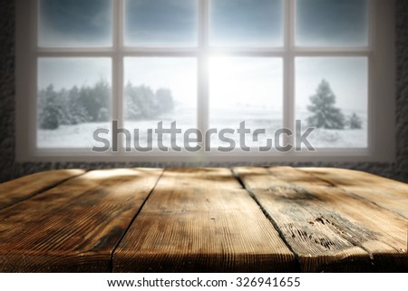 winter window and wooden table place  - stock photo