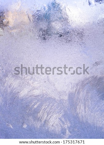 Winter window with pattern made by frost. - stock photo