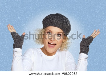 Winter woman / Beautiful blond mid adult woman enjoys the snowfall