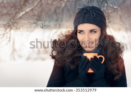 Winter Woman Holding a Hot Drink Mug - Beautiful smiling woman in wintertime decor holding a steamy beverage