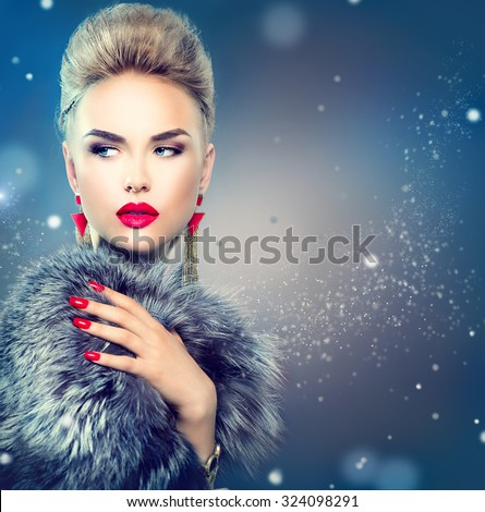 Winter Woman in Luxury Fur Coat. Beauty Fashion Model Girl in Blue Fox Fur Coat. Perfect Makeup and accessories. Beautiful Luxury Winter Lady - stock photo