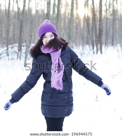 winter woman jump in park - stock photo