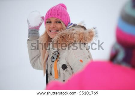 winter woman play snowballs - stock photo