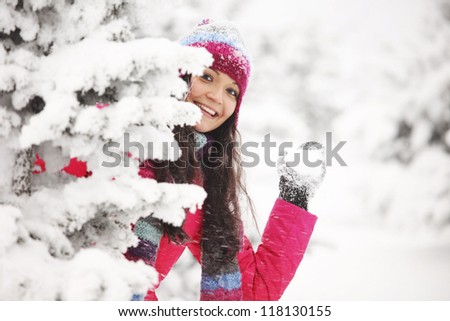 winter woman play snowballs on snow background - stock photo