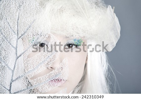 Winter Woman Portrait. Snow. Beauty Fashion Model Girl with White Hair  closeup. Make up. Asia - stock photo