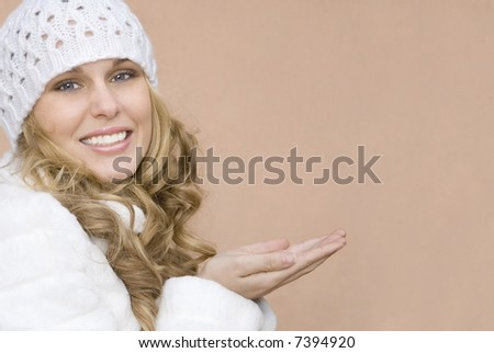 winter woman presenting something in her hands (place your product)