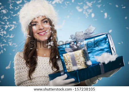 Winter woman with christmas presents  - stock photo