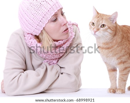 Winter woman with ginger cat isolated on white. - stock photo