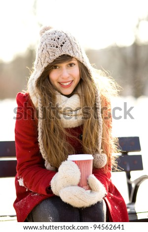 Winter woman with hot coffee - stock photo