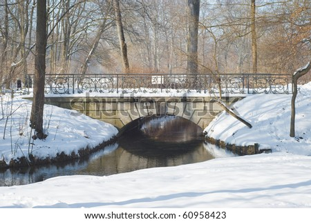 Winter Wonderland with Bridge after a Snowstorm - stock photo