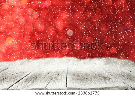 winter wooden board with snow with red space of lights  - stock photo