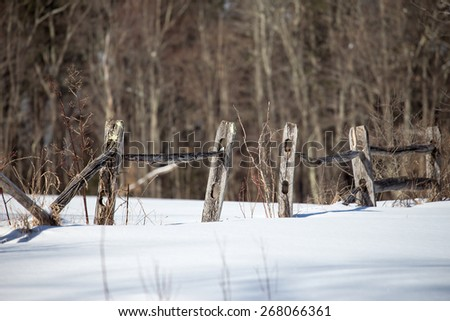 Winter wooden fence - stock photo