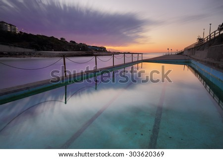 Winters dawn long exposure at Clovelly Beach Ocean Pool in Sydney's Eastern subuirbs.  218 seconds - stock photo