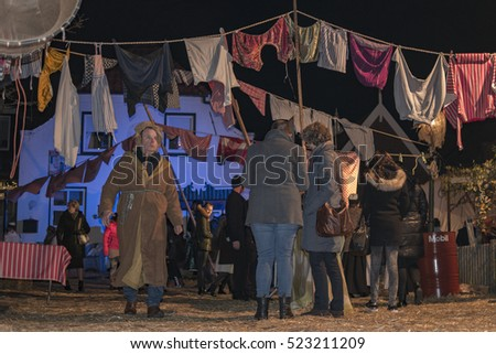 Wintersferen a traditional festival where peope wear customs from before at the streets relive the years of 1910-1920,The lights go out and the village come to life,Urk Netherlands November 2016