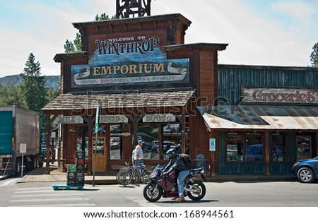 WINTHROP, WA/USA - OCTOBER 31, 2012:  The Winthrop Emporium store depicts the Wild West theme of this popular tourist attraction town.  A memory to decades ago. - stock photo