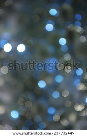 Wintry blue holiday Christmas lights background in bokeh bubbles  - stock photo