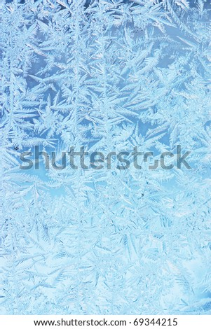 Wintry hoarfrost background on a window