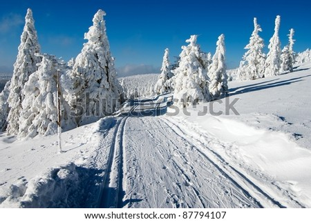 wintry landscape scenery with modified cross country skiing way - stock photo