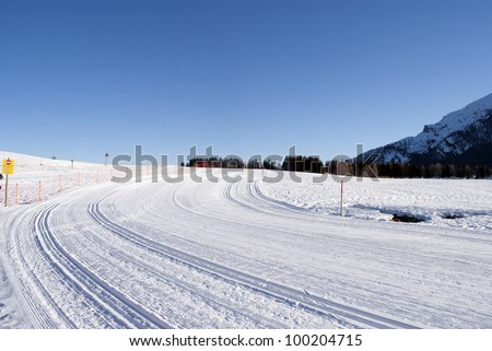 wintry landscape scenery with modified cross country skiing way. Bondone mountain in Trentino. Italy - stock photo