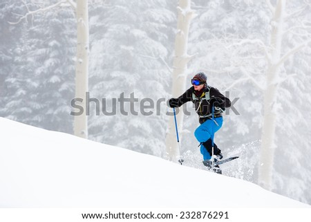 Wintry Uphill Climb on Snowshoes - stock photo