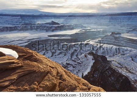 Wintry view of Pyramid Butte and the Colorado River from an overlook in Dead Horse Point State Park Utah. - stock photo