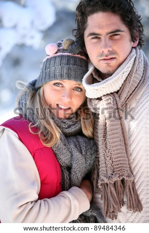 Wintry young couple - stock photo