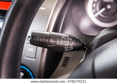Wipers control in modern car interior detail adjusting speed of screen wipers