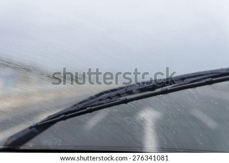 wipers on the windshield of the car in the rain - stock photo